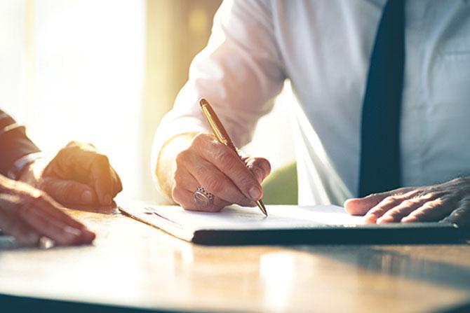 man-signing-paper